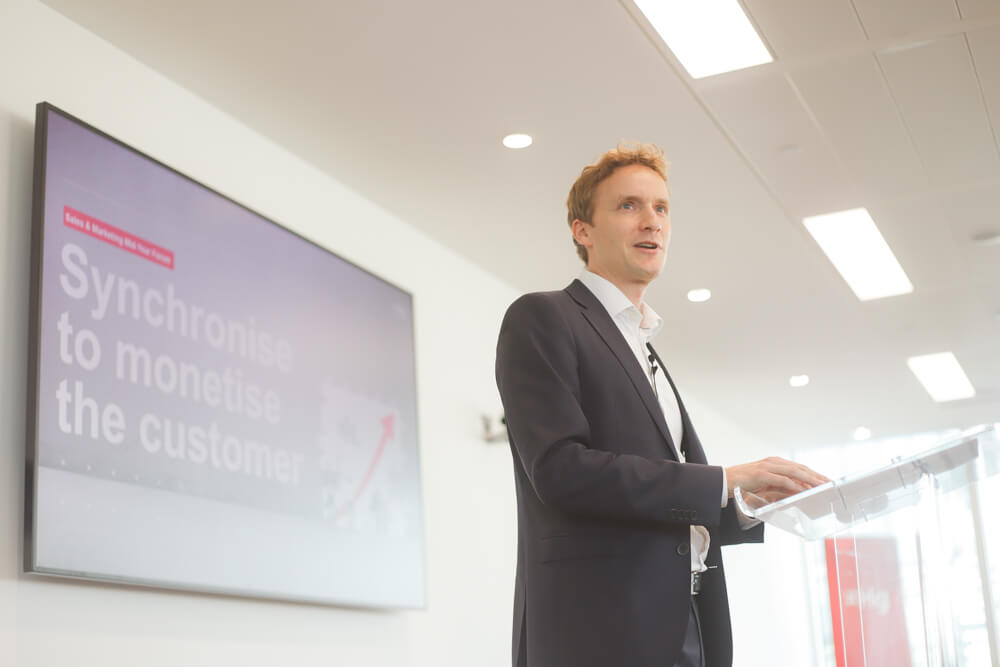 Man speaking in front of presentation